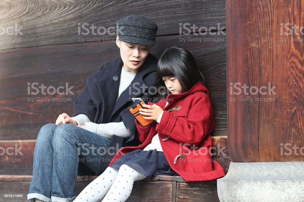 Japanese family at  Sanmon area of Tofuku temple stock photo