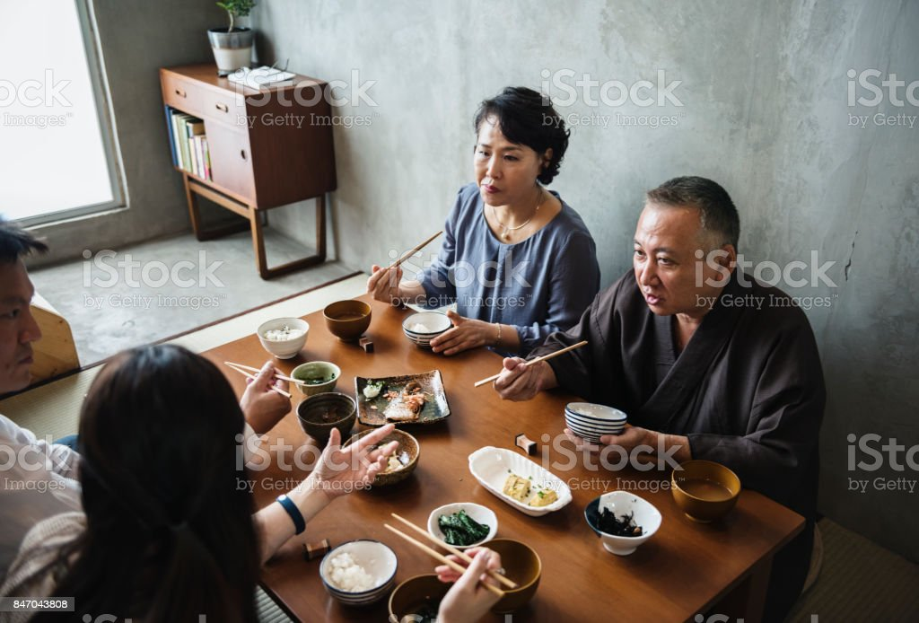 Japanese family dining together with happiness stock photo