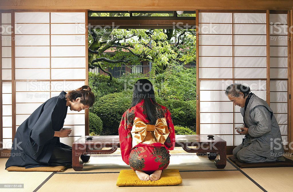 Japanese family having a tea time royalty-free stock photo