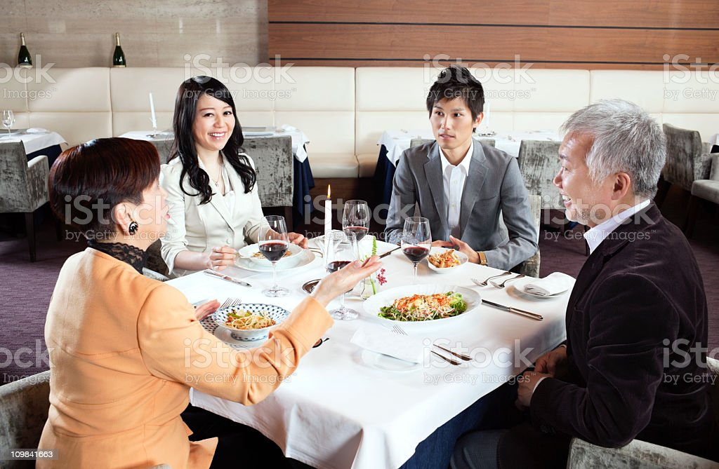 Japanese Family in a restaurant stock photo