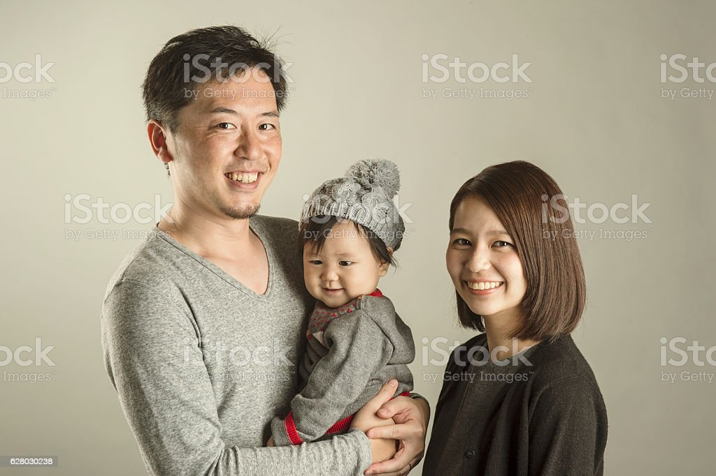 Japanese Family In Studio Shot Stock Photo & More Pictures of 20-29