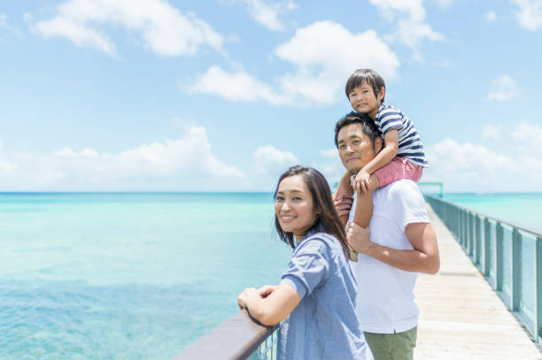 japanese family looking the sea - guam foto e immagini stock