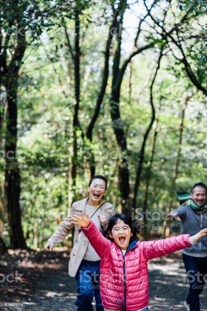 Japanese family running together Lizenzfreies stock-foto