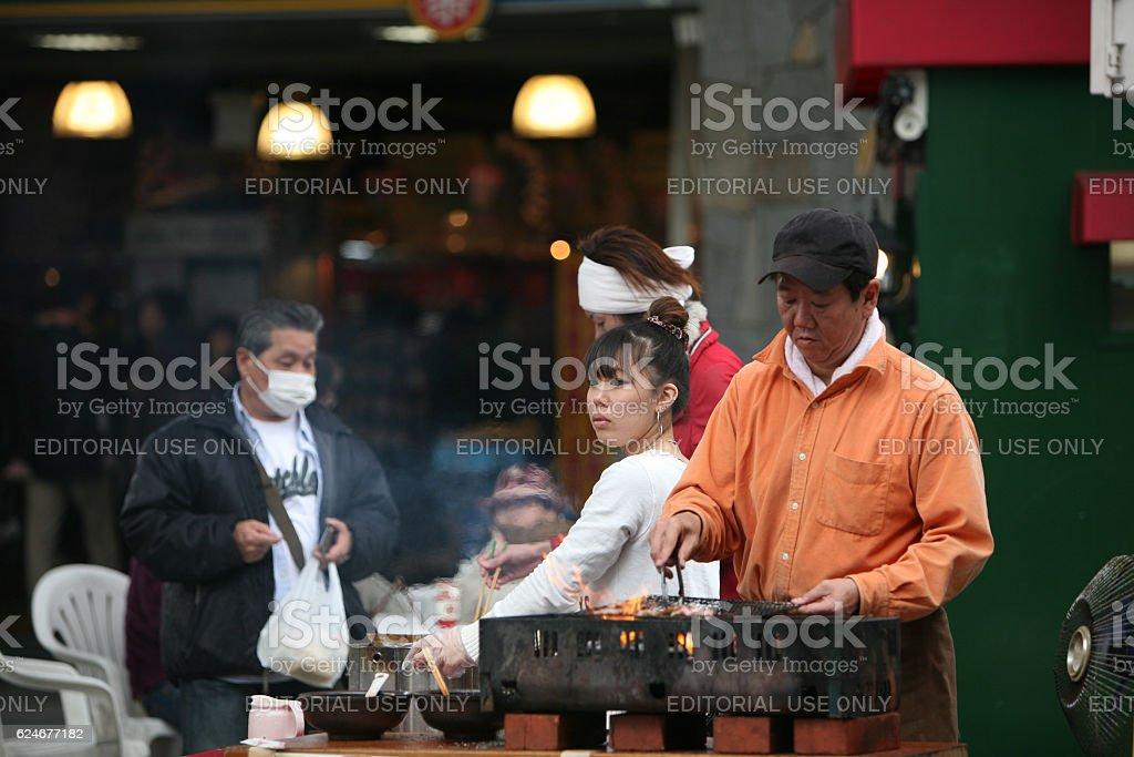 Japanese family street vendors stock photo
