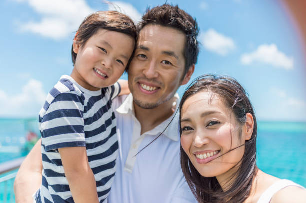 japanese family walking bridge with smile - guam foto e immagini stock