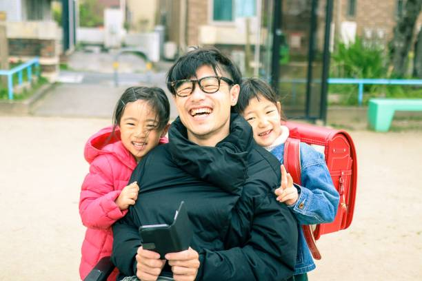 Japanese father on the wheelchair and Daughter Japanese family is having fun at the park amyotrophic lateral sclerosis stock pictures, royalty-free photos & images