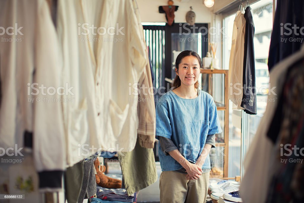 Japanese Female Resale Shop Owner in her Store ストックフォト