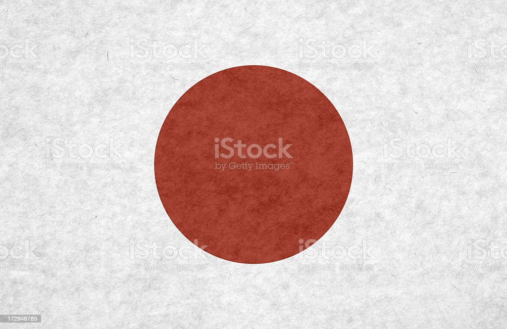 Japanese flag on mottled paper stock photo