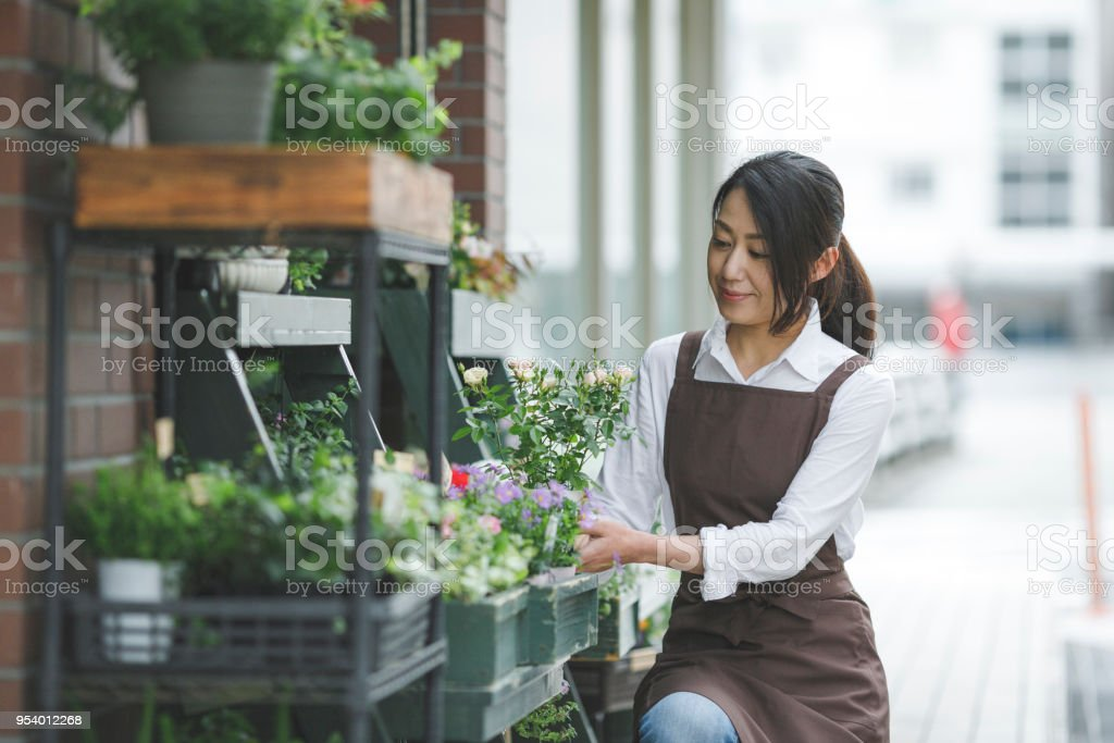 Japanese flower shop woman stock photo