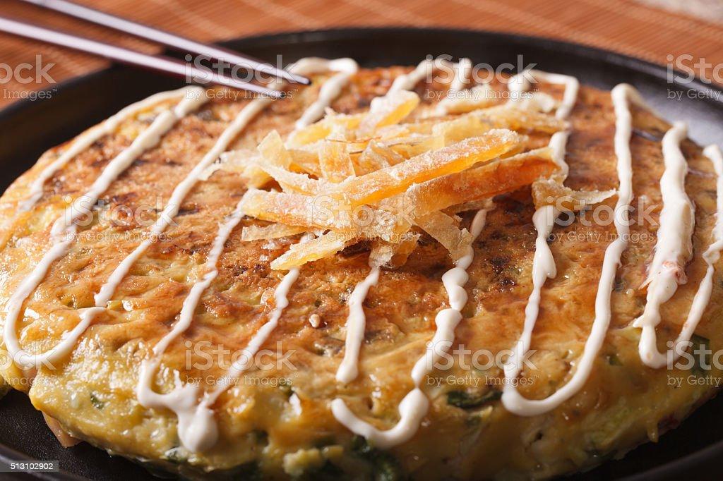 Japanese food: okonomiyaki on a plate macro. horizontal stock photo