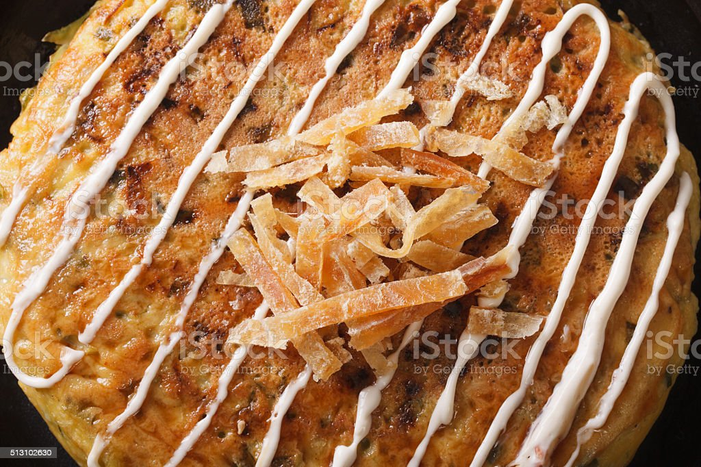 Japanese food: okonomiyaki on a plate macro. horizontal top view stock photo