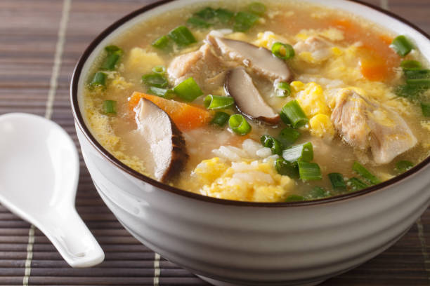 Japanese food, rice and hot pot soup calls Zosui close-up in a bowl. Horizontal stock photo