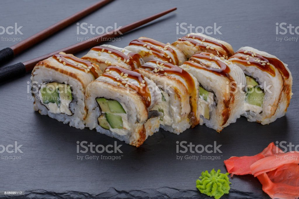 Japanese food rolls with eel fish on a black background stock photo