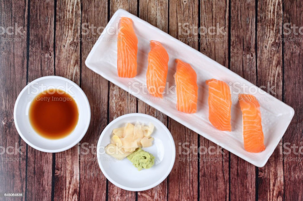 Japanese food - Salmon sushi served with side dish. stock photo