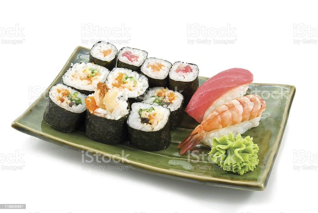 Japanese food served in a green oblong plate royalty-free stock photo