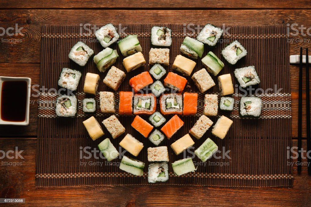 Japanese delicious and fresh set of colorful sushi rolls served on...
