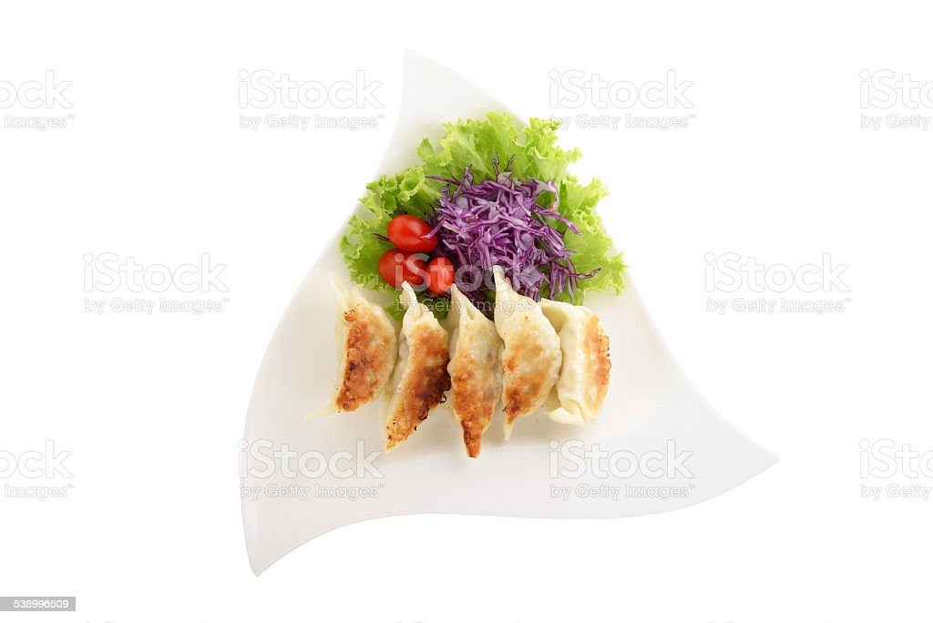 Japanese fried dumplings (Gyodza) on plate and white background stock photo