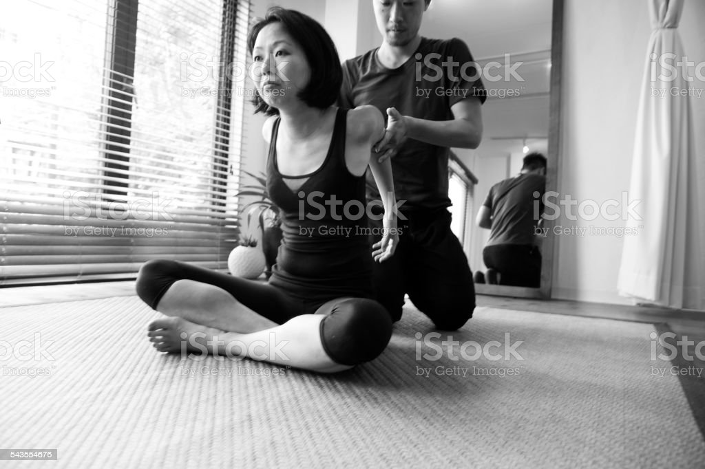 japanese friends doing physical relaxation exercise in studio  kyoto japan stock photo