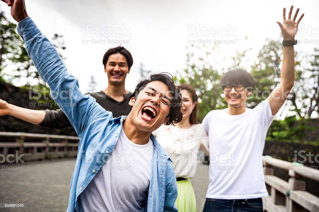 Japanese friends hanging out together in the city stock photo