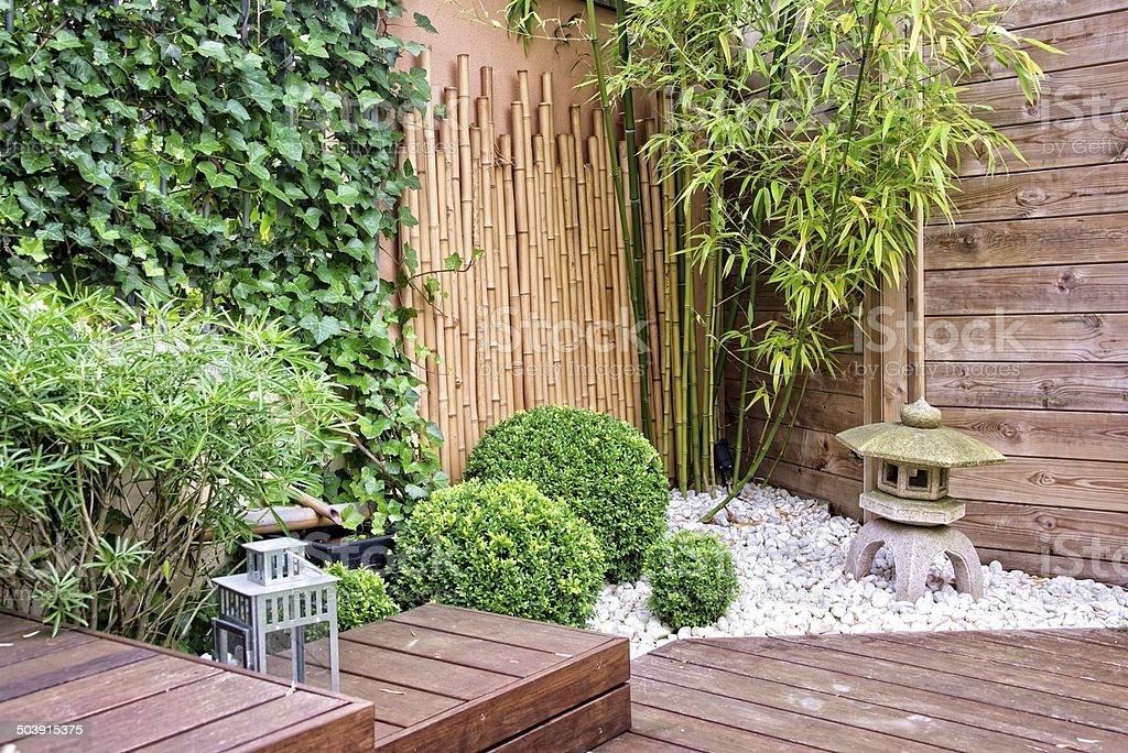 Japanese garden with bamboos and stone lantern stock photo