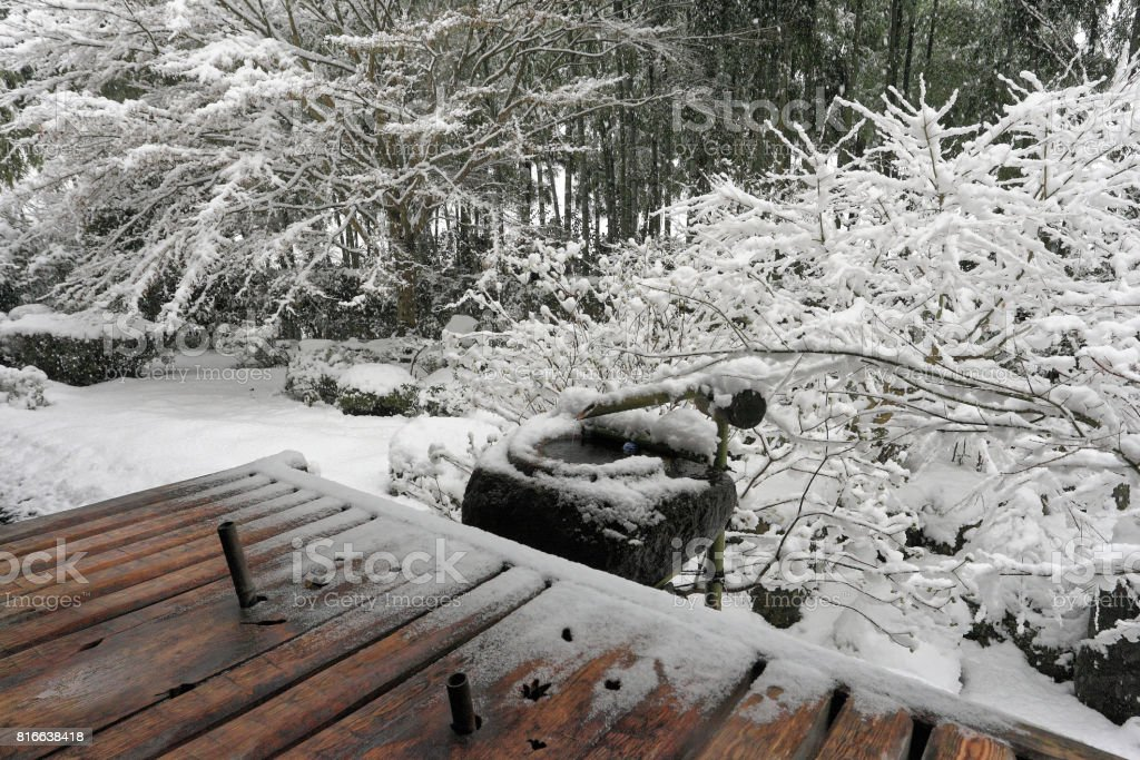 Japanese garden with snow stock photo