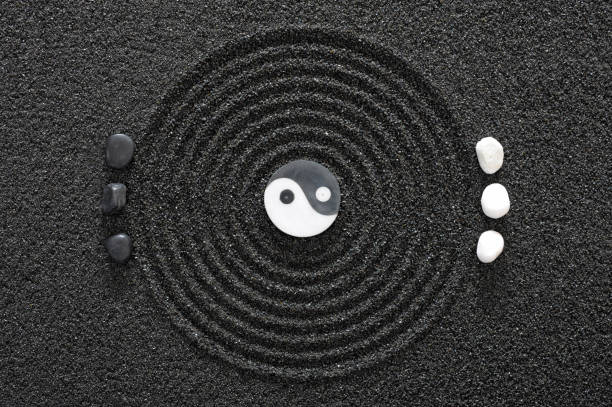 japanese garden with yin and yang stones in raked sand - yin yang symbol stock pictures, royalty-free photos & images