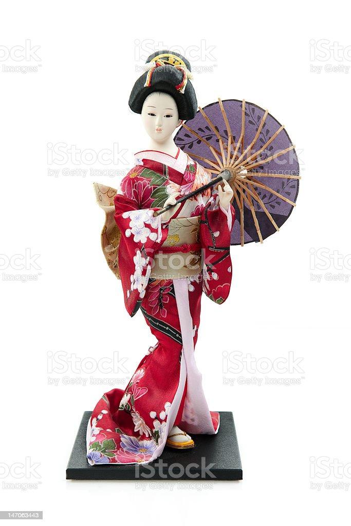 Japanese geisha doll isolated on white. stock photo