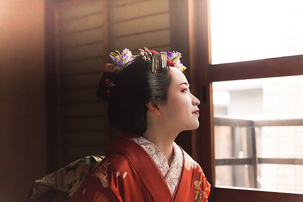 japanese geisha looking through the window - geisha girl stock photos and pictures
