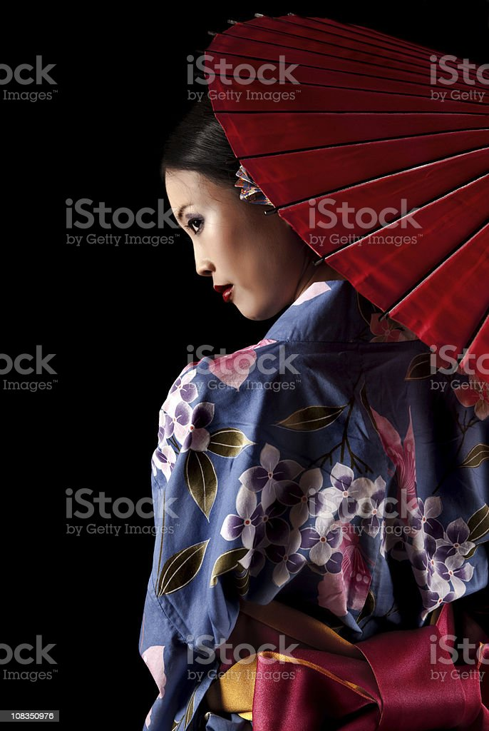 Japanese geisha with a red umbrella stock photo