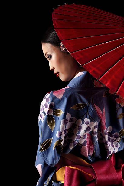 japanese geisha with a red umbrella - geisha girl stock photos and pictures