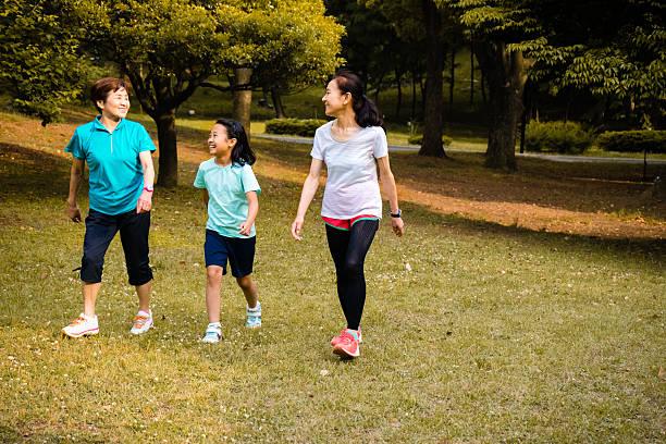 Japanese girl and senior women walking in the park stock photo