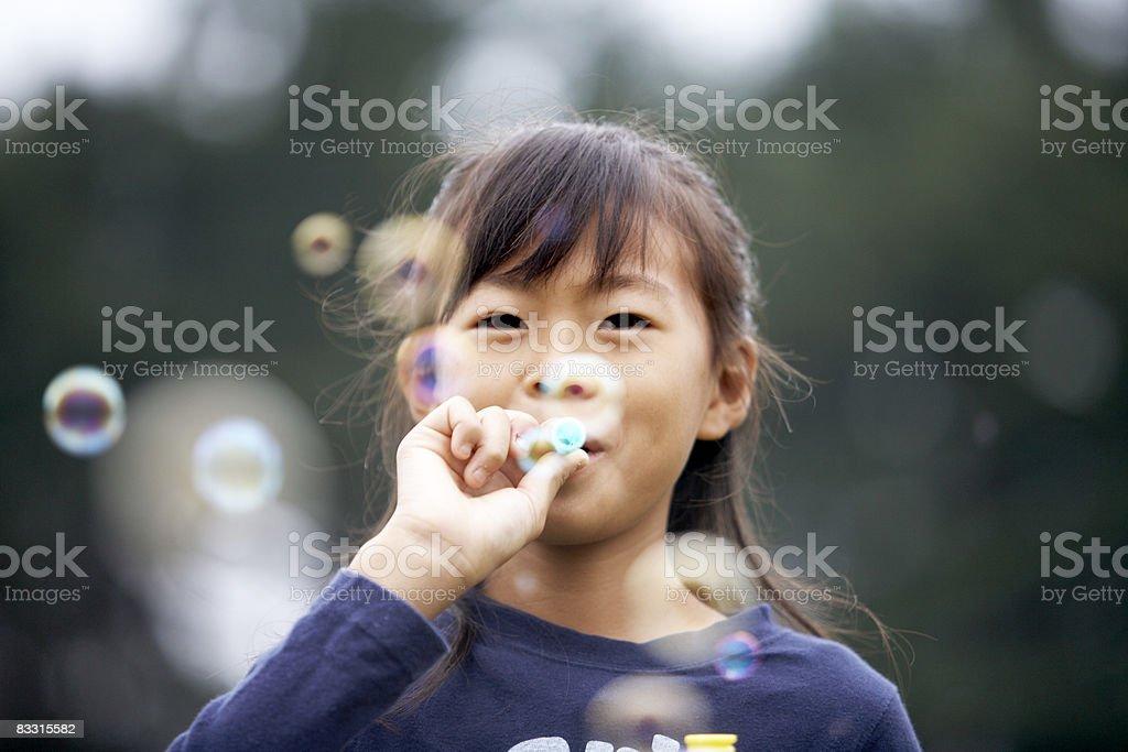 Japanese Dziewczyna wieje pęcherzyki powietrza zbiór zdjęć royalty-free