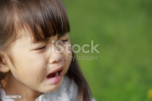 Japanese girl crying on the grass (4 years old)