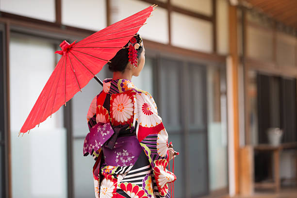 Japanese Girl in Kimono at Hyakumanben Chionji Temple, Kyoto, Japan A young woman in traditional Kimono admiring the magnificent architecture of Hyakumanben Chionji Temple in Kyoto, Japan geisha stock pictures, royalty-free photos & images