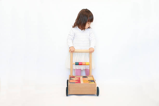 Japanese girl pushing a cart (2 years old) stock photo