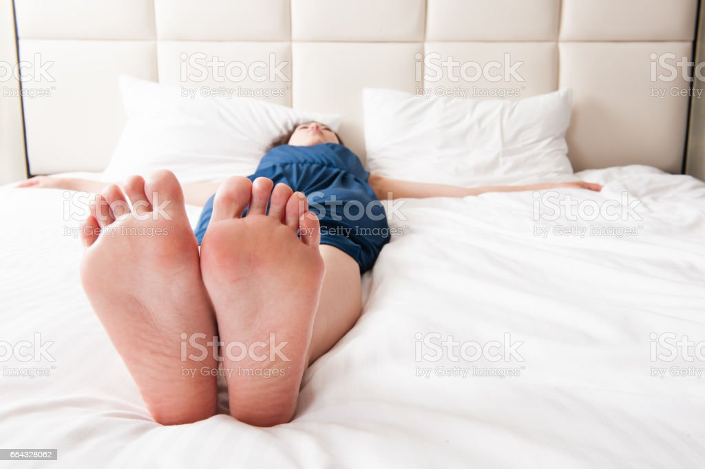 japanese girl sleeping on the bed soles stock photo & more pictures