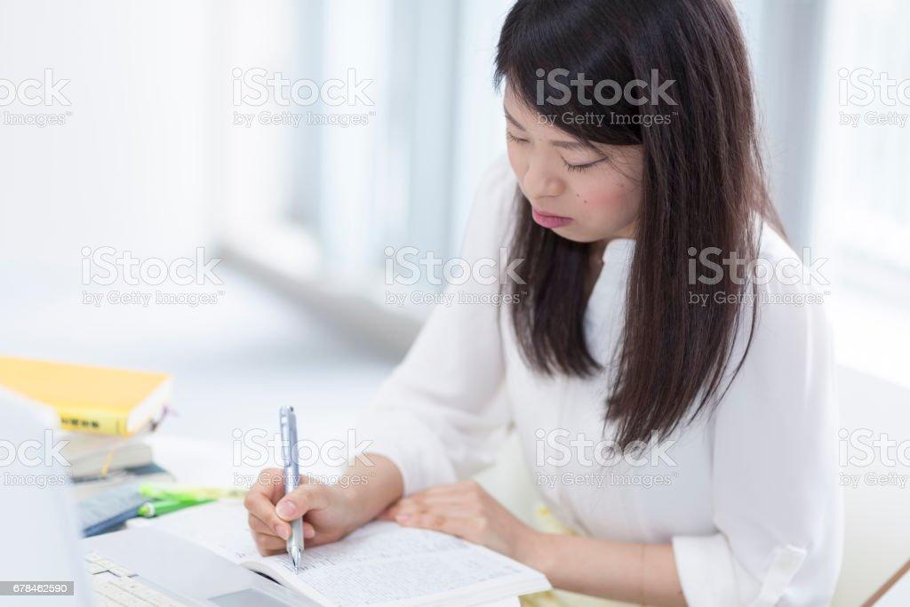 Japanese Girl Studying royalty-free stock photo