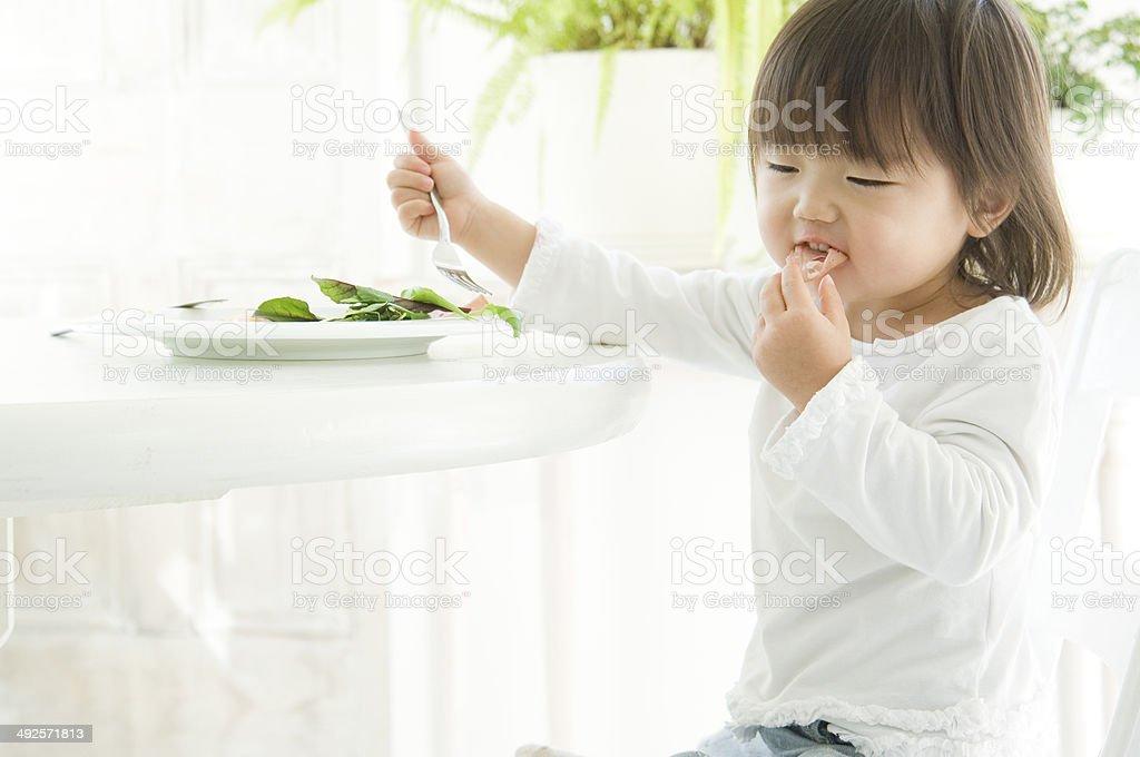 Japanese girl taking meal royalty-free stock photo