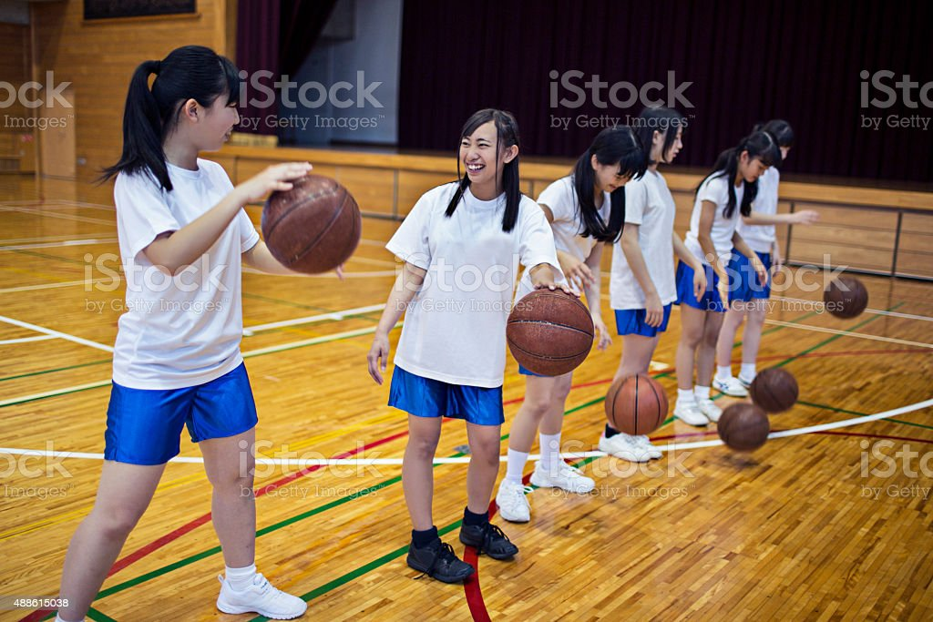 Japanese girls practising basketball in the school gymnasium stock photo