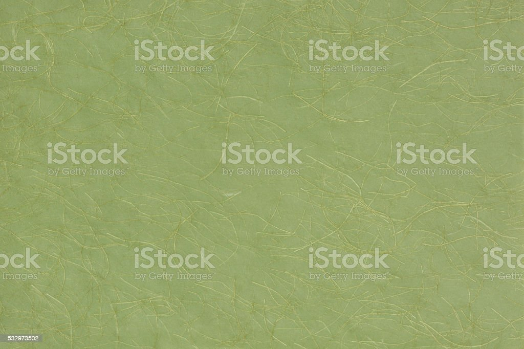 Japanese green paper with gold thread. stock photo