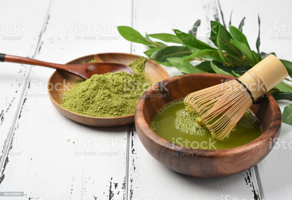 Japanese green tea matcha in a wooden bowl. royalty-free stock photo