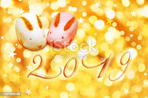 1049972562 istock photo 2019 japanese greeting card with rabbit shaped pastries and golden background 1051686168