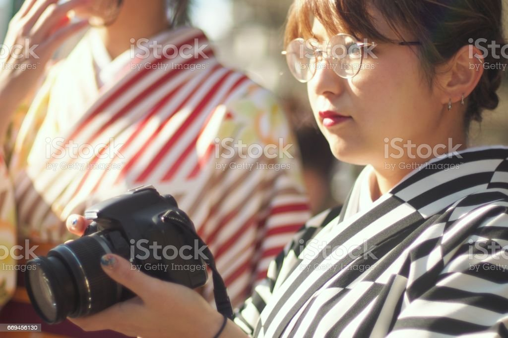 Japanese having a camerawoman in kimono stock photo