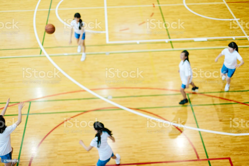 Japanese high school. A school gymnasium. Children play basketball stock photo
