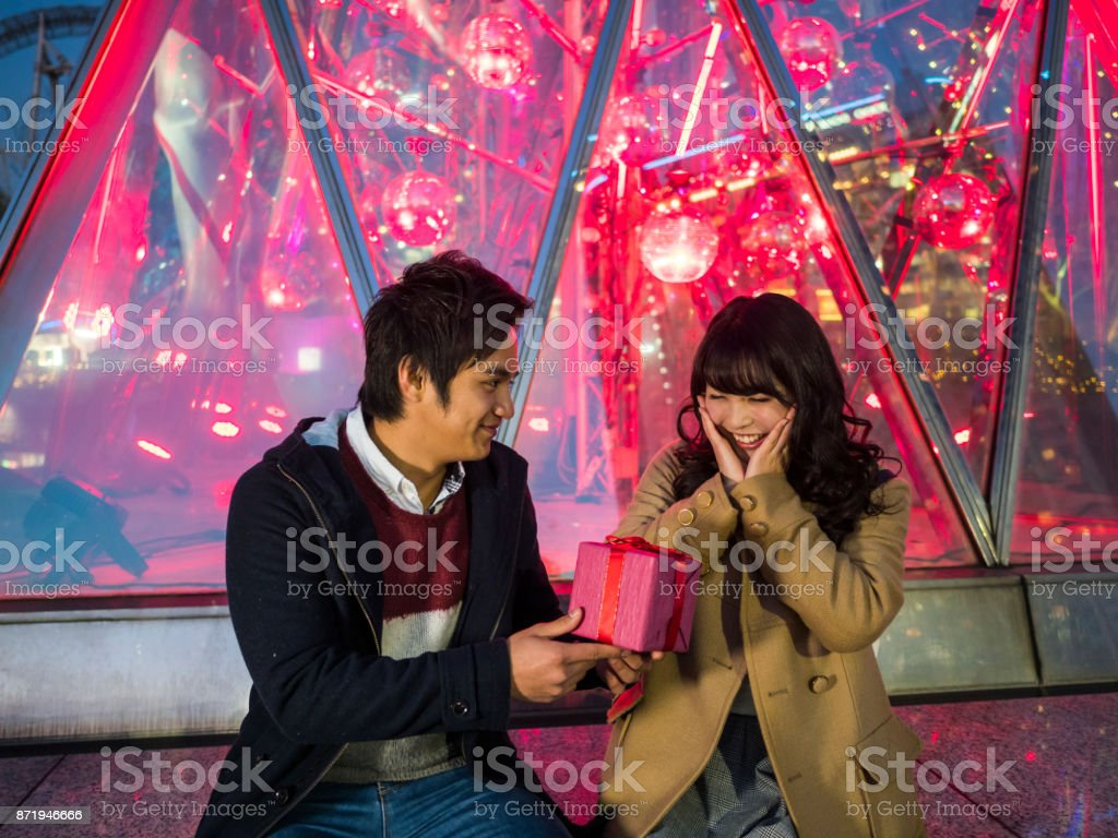A Japanese high school girl surprised by a sudden gift of a boyfriend. stock photo
