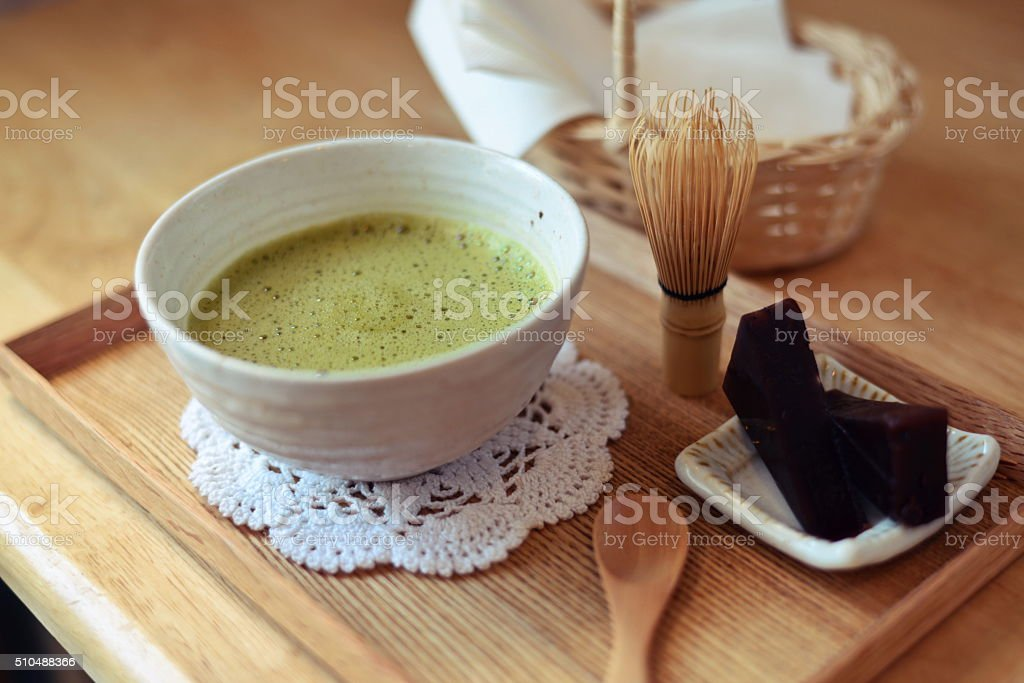 Japanese hot green tea and wire whisk made of bamboo stock photo