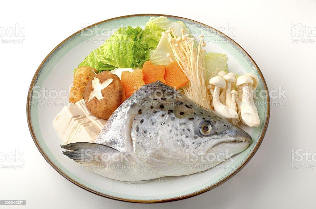 Japanese hot pot - salmon's head with mushrooms stock photo