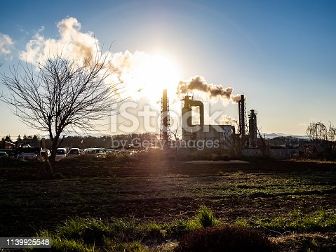 istock Japanese industrial complex silhouette in late afternoon 1139925548