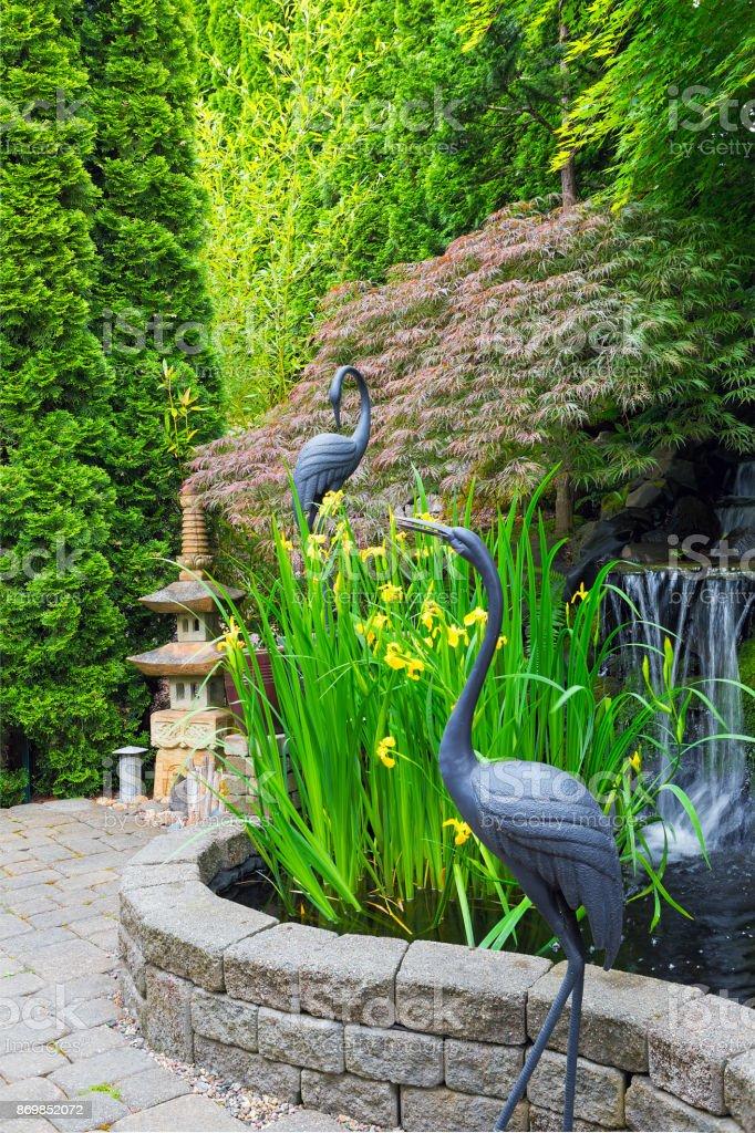 Japanese Inspired Backyard Home Garden With Bronze Cranes Stone ...