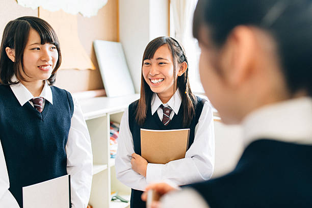 Japanese Junior High School Girl Students in Between Classes Japanese Junior High School Girl Students hanging out in between classes female high school student stock pictures, royalty-free photos & images